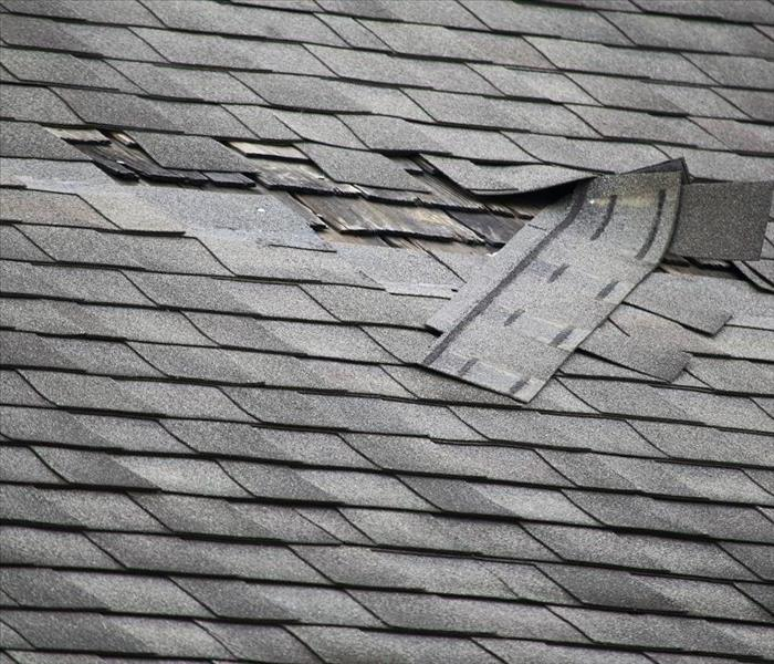 Storm Damage Roof Holes Can Create Attic Flood Damage to Your Eureka Springs Home